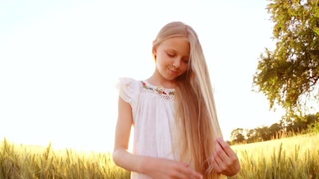 Portrait Adorable Little Girl Smiles outdoor at sunset video