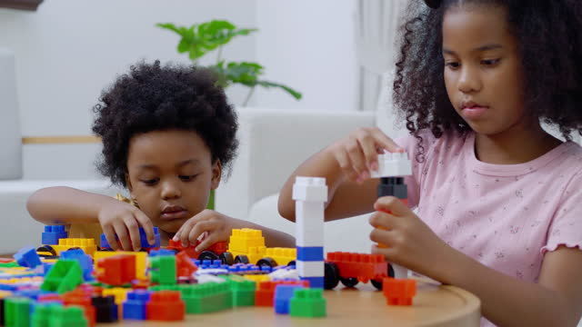 Portrait african ethnicity of little boy and girl age 3,9 years old playing with colorful toy blocks while homeschooling stay at home to prevent epidemics of Coronavirus or Covid-19.Day in the Life of a Family video
