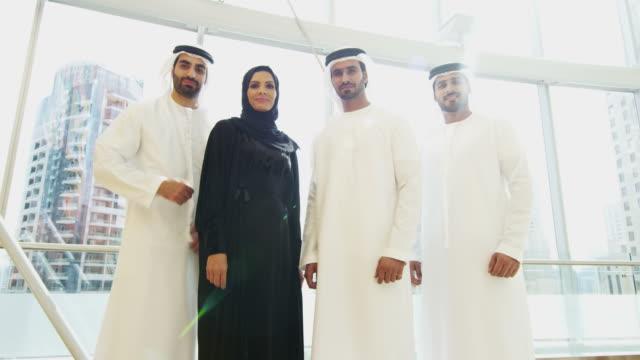 Portrait Arab business team wearing national dress downtown video