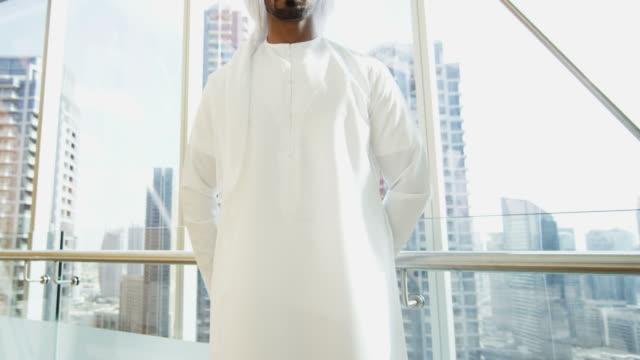 Portrait Arab global businessman wearing kandura downtown Dubai video