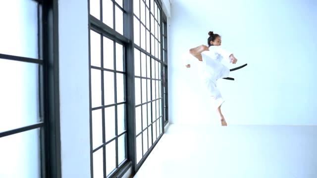 Portrait asian girl taekwondo in studio