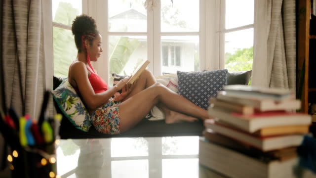 Portrait Black Woman Reading Book And Smiling At Camera video