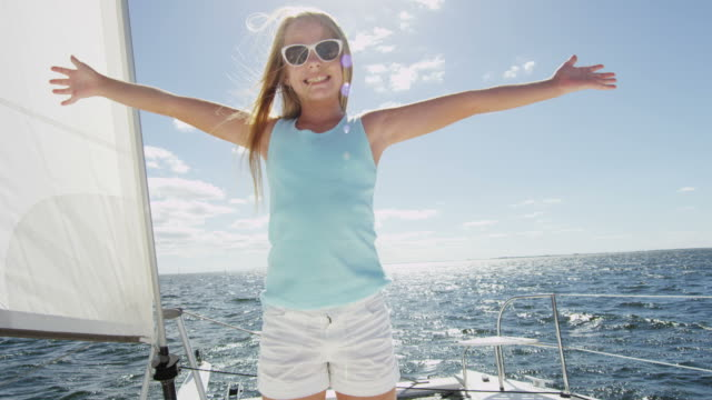 Portrait blonde Caucasian girl on family luxury yacht video