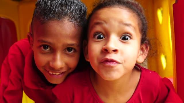 portrait boy and girl looking to the camera - spanish and portuguese ethnicity stock videos & royalty-free footage