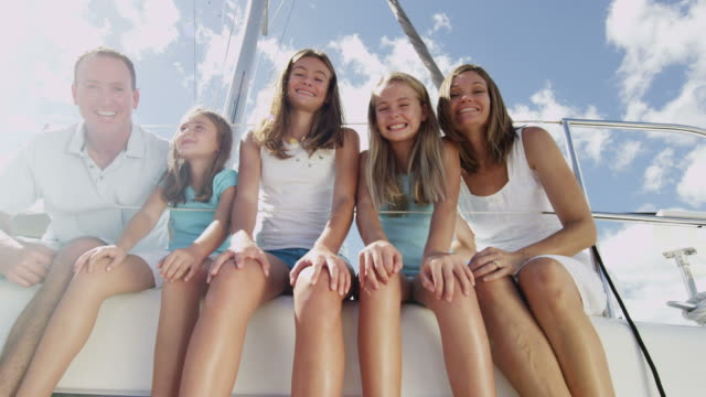 portrait caucasian family outdoors on luxury yacht vacation - financial planning stock videos & royalty-free footage