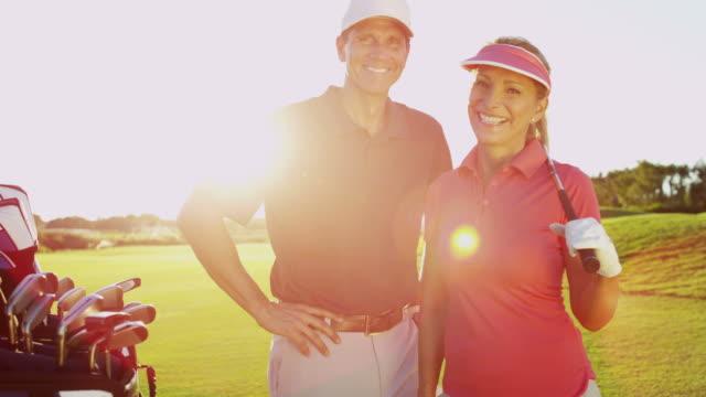 Portrait Caucasian male female golfers on golf vacation video