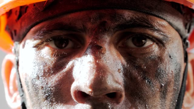 portrait dirty worker looking at camera. sweaty exhausted man in a hard hat. filthy job and physical labor. coal mining. people working equipment. close up. - imperfection stock videos & royalty-free footage