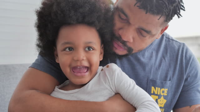 Portrait family of african father with little boy spending time together at home.Dad and child tenderness moments.Father, Father's Day, Celebration, Togetherness, Bonding, Admiration, Love-Emotion, Family, Single father - vídeo