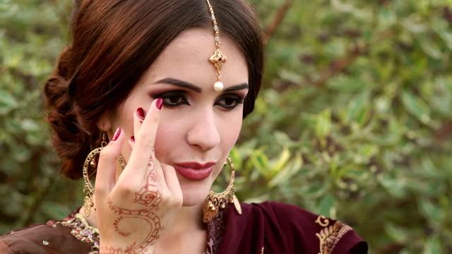 Portrait girl in Indian traditional dress, mehendi video