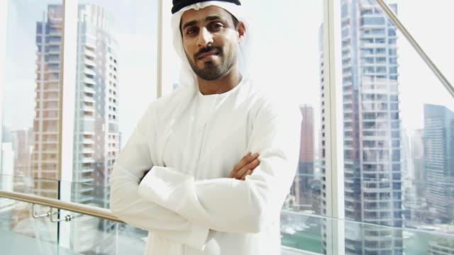 Portrait male Arabic business consultant national dress downtown video