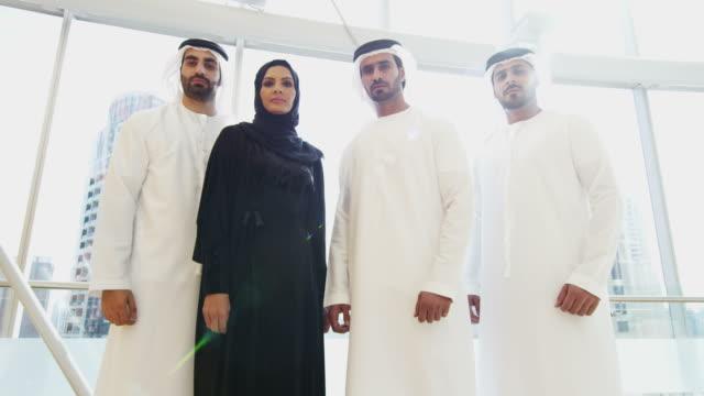 Portrait male female Arabic business team national dress video