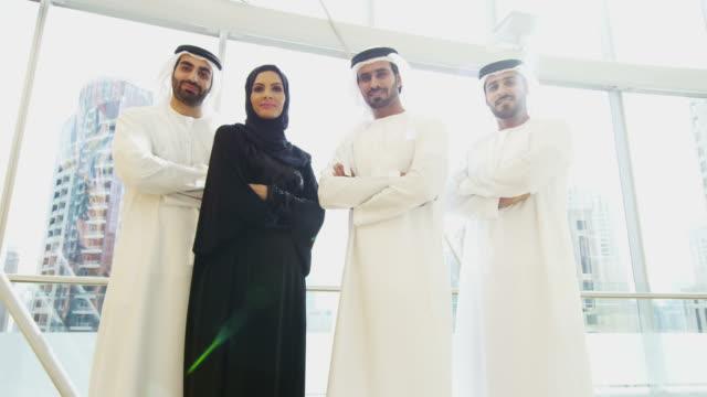 Portrait male female Emirati business team national dress video