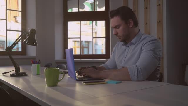 Portrait man works in office video
