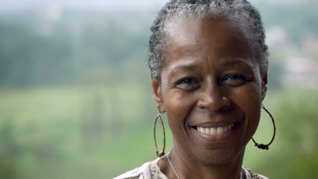 Portrait of a beautiful African American woman in her 60s smiling video