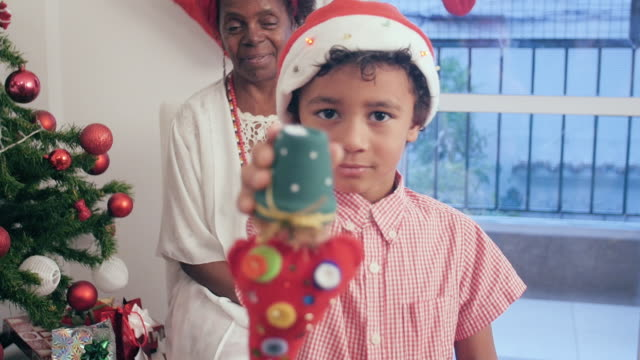 Portrait of a black boy with a christmas present