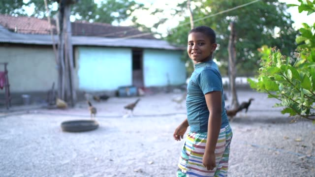 Portrait of a boy outdoors in a rural scene