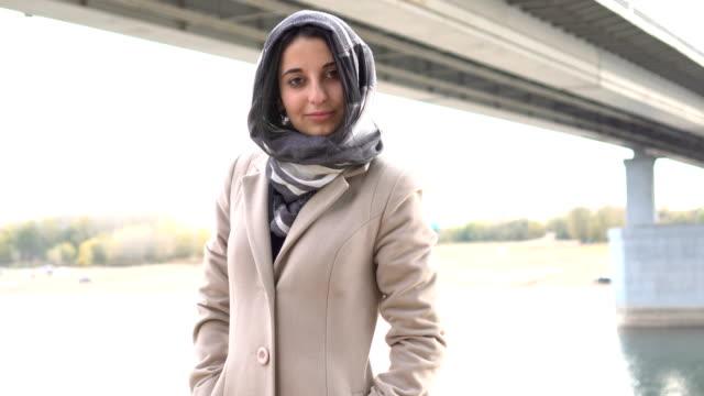 portrait of a brunette muslim girl, outdoors - hijab video stock e b–roll