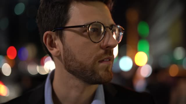 Portrait of a business man in the city at night Portrait of a young man in the city at night são paulo state stock videos & royalty-free footage