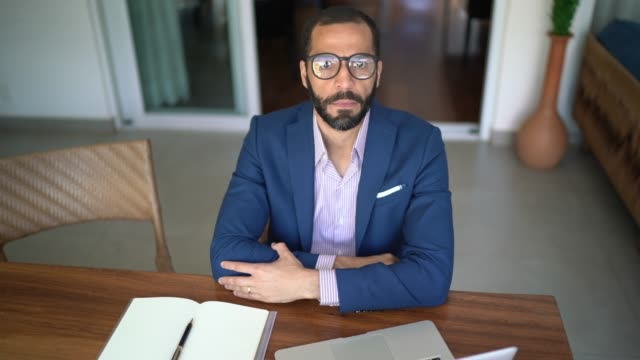 Portrait of a businessman working from home Portrait of a businessman working from home financial planning stock videos & royalty-free footage