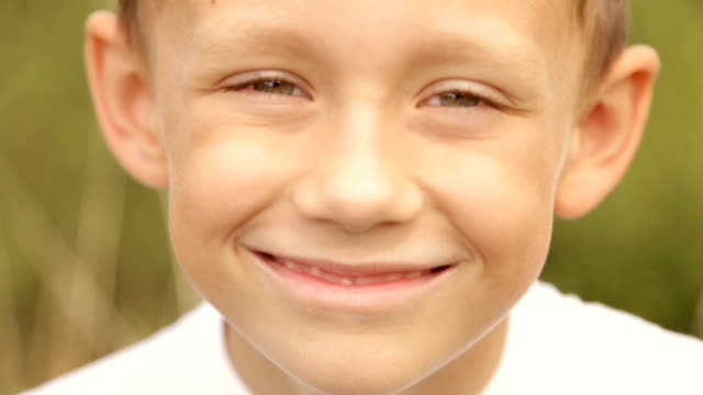 Portrait of a child close-up in nature Portrait of a boy outdoors one boy only stock videos & royalty-free footage