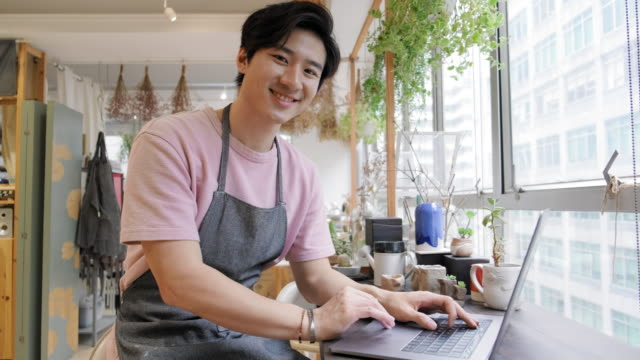 Portrait of a Chinese Male Artist and Business Owner Using Laptop video
