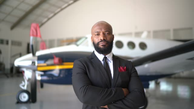 Portrait of a confident man looking at camera in a hangar