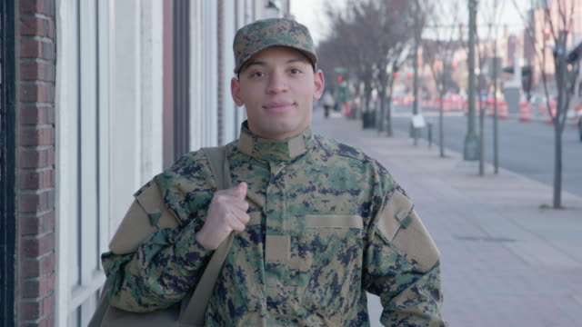 Portrait of a Confident Military Man Portrait of a confident soldier in an urban setting. camouflage clothing stock videos & royalty-free footage