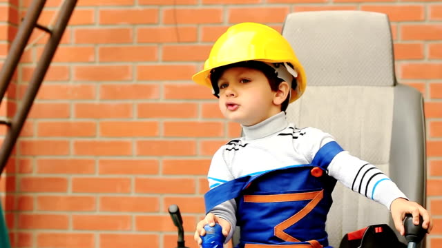 portrait of a cute boy as excavator operator - agricultural machinery stock videos & royalty-free footage