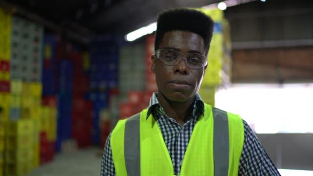 portrait of a engineer at warehouse - prodotti supermercato video stock e b–roll