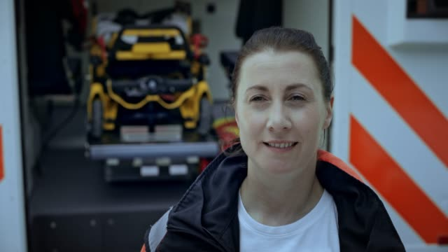 Portrait of a female paramedic standing next to the ambulance video