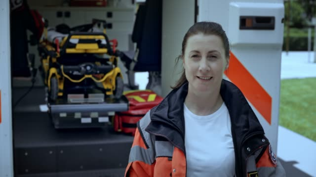 portrait of a female paramedic - paramedic stock videos and b-roll footage
