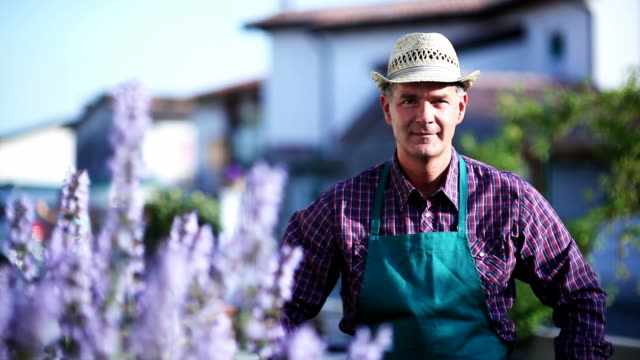 Portrait of a Gardener At Work; Full HD Photo JPEG video