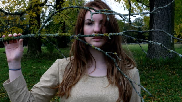 Portrait of a Girl Holding a Bare Branch video