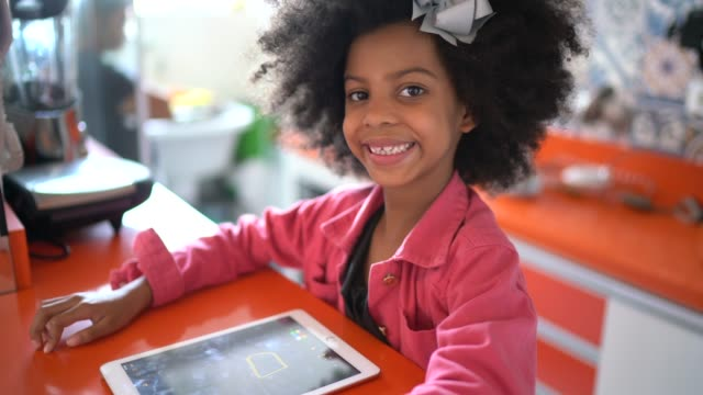 Portrait of a girl using digital tablet at home