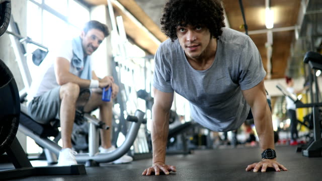 Portrait of a handsome man doing push ups exercise in gym Portrait of a handsome man doing push ups exercise in fitness gym bodyweight training stock videos & royalty-free footage