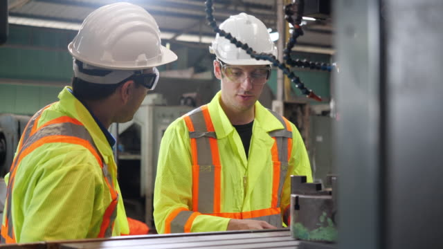 Portrait of a happy man and friend worker or engineer working together Portrait of a happy man and friend worker or engineer working together manufacturing equipment stock videos & royalty-free footage