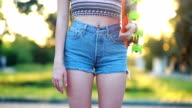 istock Portrait of a hipster young girl smiling with a skateboard at sunset. 1250124646