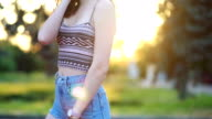 istock Portrait of a hipster young girl smiling with a skateboard at sunset. 1250126588