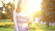 istock Portrait of a hipster young girl smiling with a skateboard at sunset. 1250127174