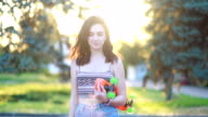 istock Portrait of a hipster young girl smiling with a skateboard at sunset. 1250133584