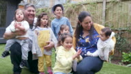 istock Portrait of a large family with children in the back garden 1161210103