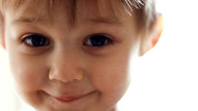 Portrait of a little boy in slow motion video