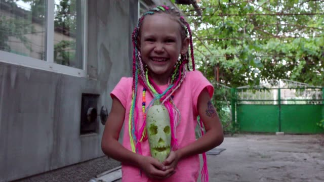 Portrait of a little girl with dreadlocks in a rural yard Portrait of a little girl with dreadlocks in a rural yard pigtails stock videos & royalty-free footage