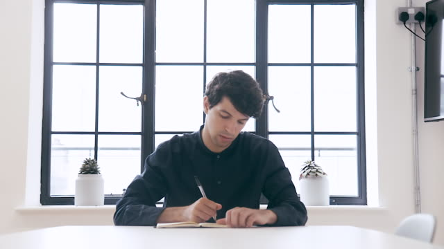 portrait of a male designer (slow motion) - notepad stock videos & royalty-free footage