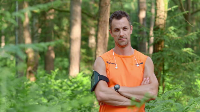 SLO MO DS Portrait of a male runner in the forest video