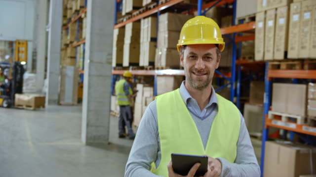 Portrait of a male warehouse supervisor video