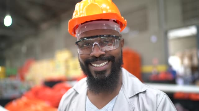 Portrait of a man in a factory Portrait of a man in a factory manufacturing occupation stock videos & royalty-free footage