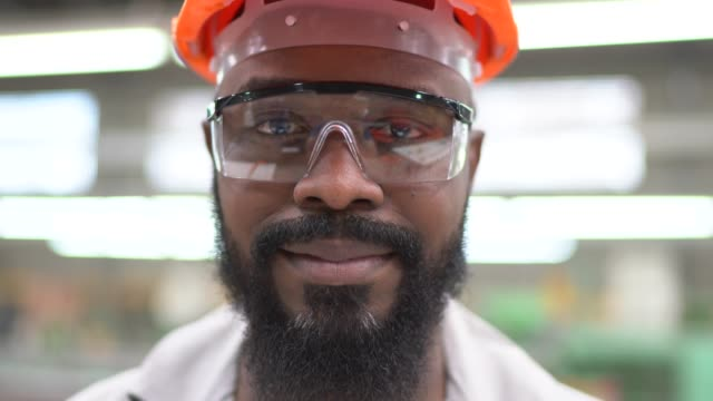 Portrait of a man in a factory Portrait of a man in a factory production line worker stock videos & royalty-free footage
