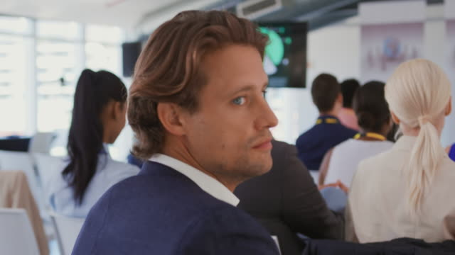 Portrait of a man in the audience at a business conference