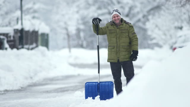 HD: Portrait Of A Man Shoveling The Snow video